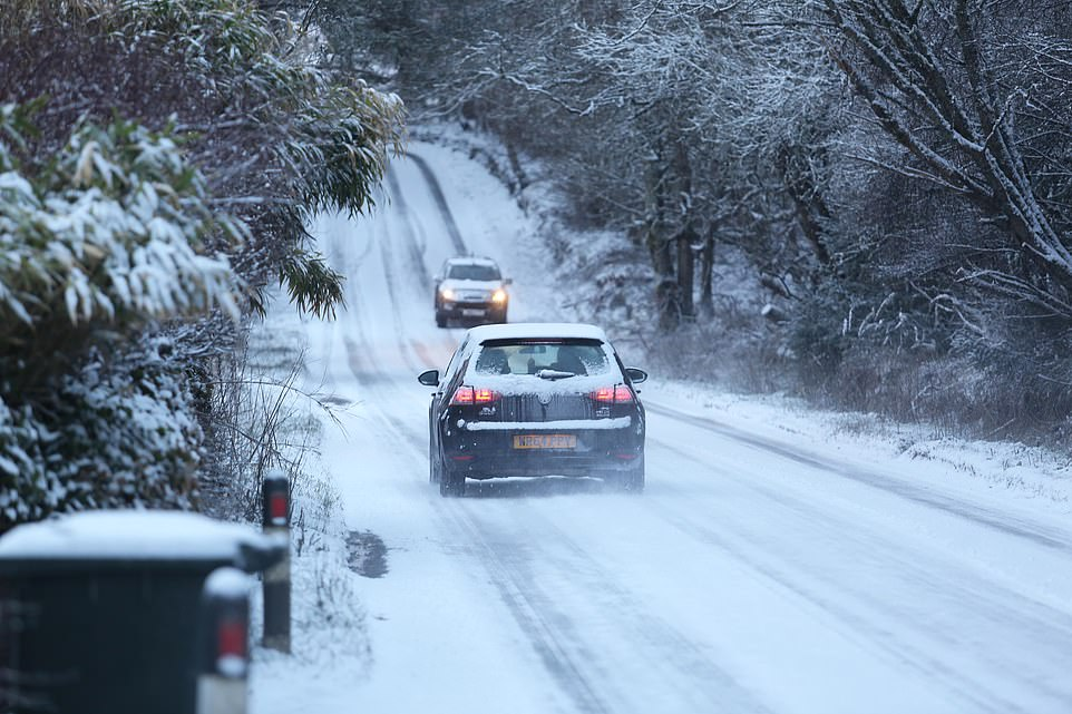 TODAY: Traffic on the A832 near Muir of Ord this morning as snow sweeps in across the Highlands on what is expected to be a bitterly cold day