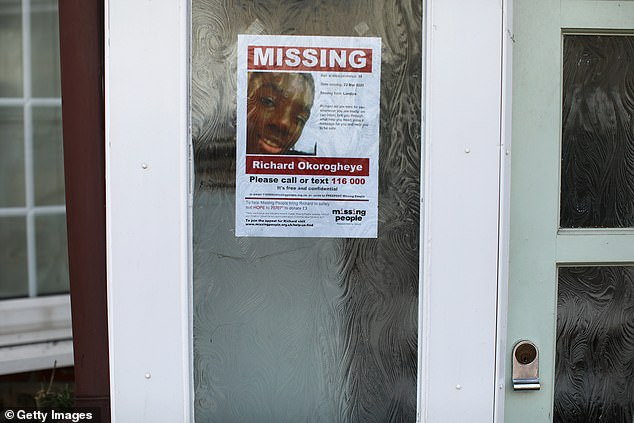 A 'missing' poster for Richard Okorogheye is displayed in a window of a house on April 1, in Loughton, England