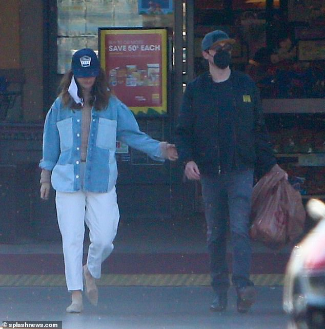 Out and about:The couple seemed smitten as they were seen heading out to buy groceries in Los Angeles on Easter Sunday