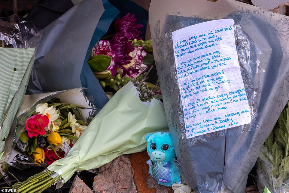 One letter contained a poem for the baby, while other mourners left behind flowers and stuffed toys as tributes to him