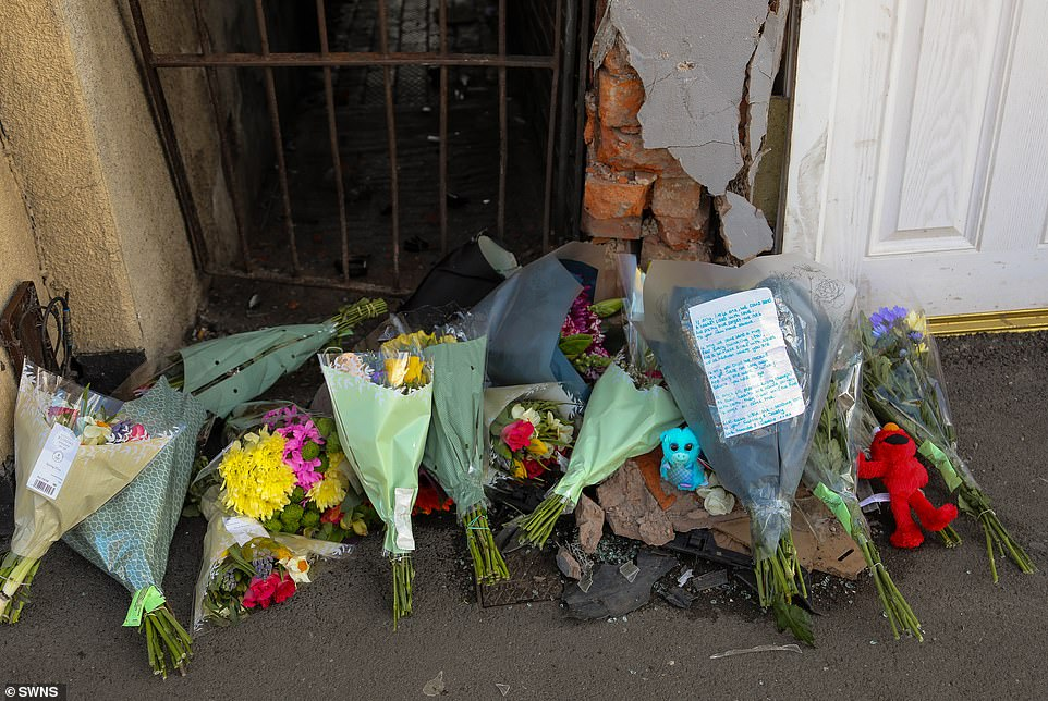 The point at which the car smashed into the shop front, which was marked by flowers left by well-wishers yesterday