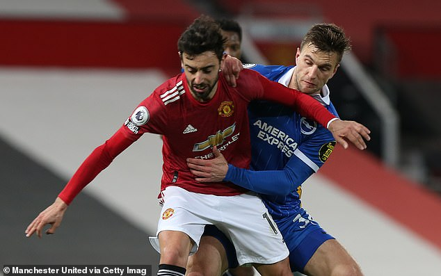Fernandes (pictured holding off Veltman) was scythed down before Marcus Rashford's leveller