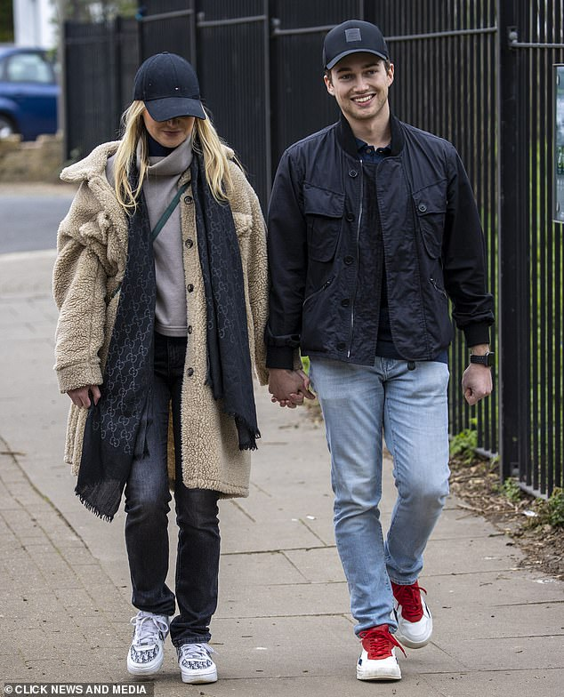 Sweet:The dancer was sweetly supported by her boyfriend AJ, who wore a casual outfit, and they walked hand-in-hand during a stroll in a local park