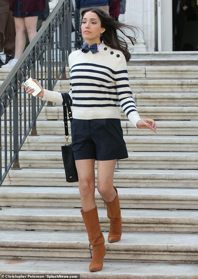 Prep school chic:Zion Moreno was preppy in a striped sweater and tan calf skin boots