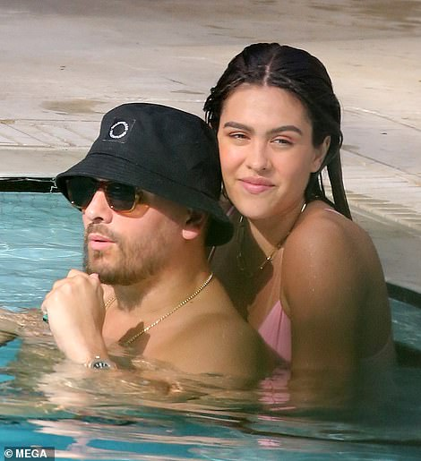 No hiding it: The pair put on a very affectionate display in the public pool as they cozied up to one another in the water