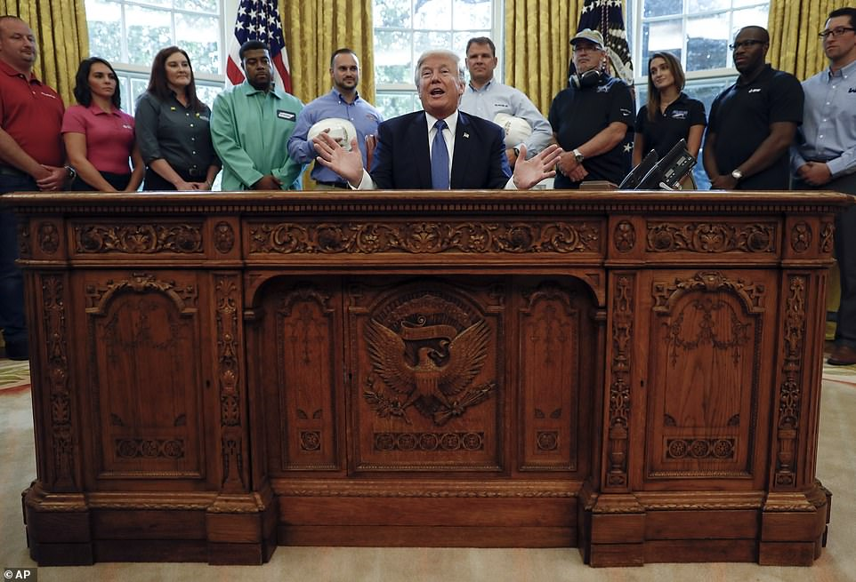 Location, location: Trump at his old desk, the historic Resolute Desk that belongs to the government, in the Oval Office