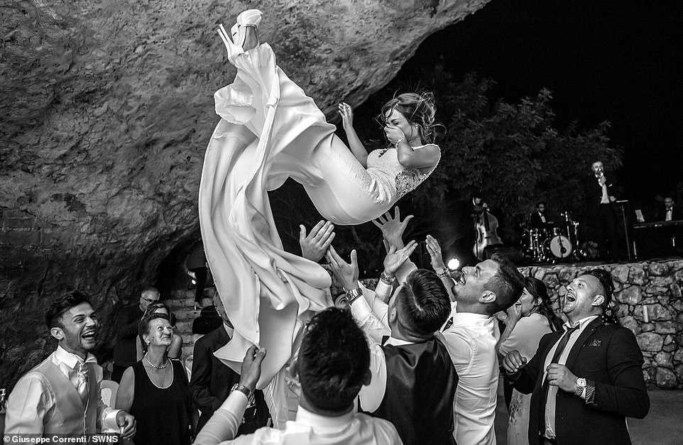 The joy of a wedding is captured perfectly in the winner of the Wedding category shot by Sicilian photographer Giuseppe Correnti. Father-of-three Giuseppe, a professional photographer from Catania, said: 'The photograph was taken during a wedding in Sicily, at the time of the dances'