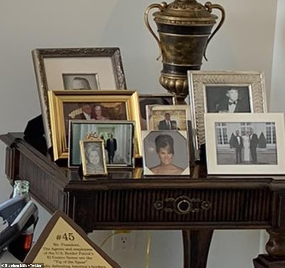 Trump's side table featured a picture of his father (back left), him as a young man (back right), wife Melania (center) and son Barron, 15 (center, middle). To the left at the front appeared to be his mother, Mary, who died in 2000