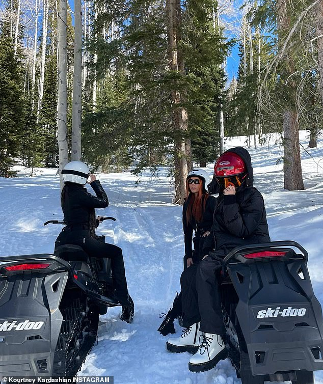 Winter moments: Another gallery saw the eldest Kardashian sister on snowmobiles with Travis's daughter Alabama Luella, 15, and her half-sister Atiana De La Hoya, 22