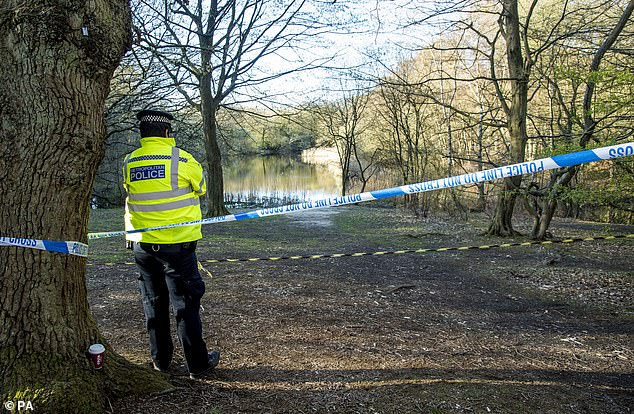 Metropolitan Police officers at the scene at the Wake Valley pond in Epping Forest following the discovery of a man's body. April 6