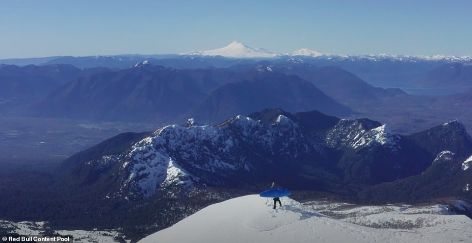 Daredevil kayaker Aniol Serrasolses at the top of Villarrica, one of Chile's most active volcanoes, before starting his stunt