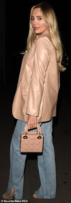 Unfazed:She teamed her straight-leg jeans with a leather-look nude blazer and a teal vest while Nicole, 29, commanded attention in a ruffled mini dress adorned with sequins
