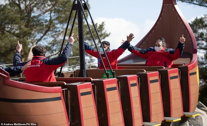 Legoland Windsor workers show how visitors will be required to wear face masks while going on rides at the park