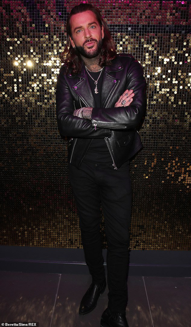 Black is always in fashion:The Essex lothario, 32, arrived in style, sporting a leather jacket and complementing black ensemble