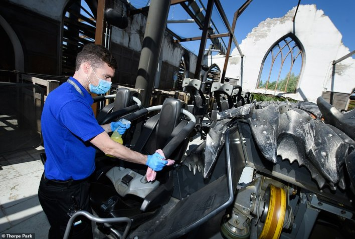 A Thorpe Park worker carries out cleaning of the restraint on The Swarm ride as the park prepares to reopen