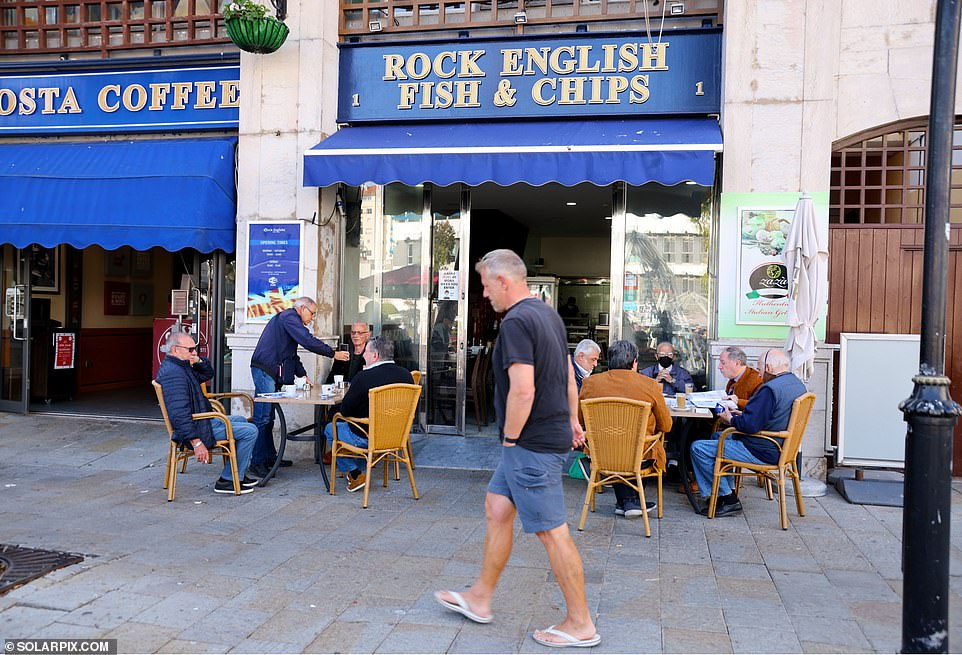 All shops are open now - including non-essential ones - and to get into bars, cafés (pictured) and restaurants no-one needs to show any kind of vaccine passport