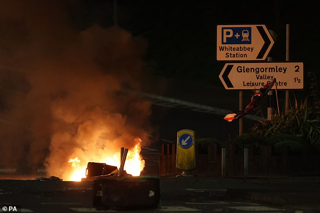 Photographs from Tuesday captured bins being set alight and rocks and fireworks being launched at officers on the approach to Larne, County Antrim