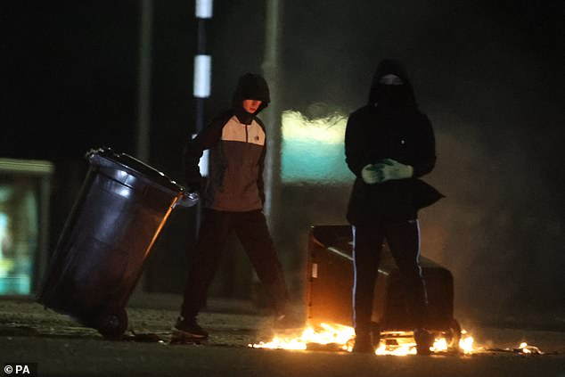 Bins are set ablaze at Cloughfern roundabout in Newtownabbey, Northern Ireland, on Tuesday