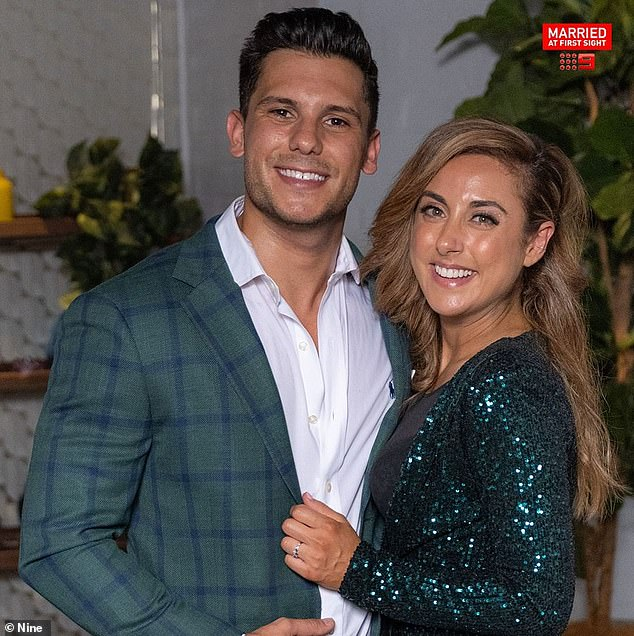 Standing by her man:Married At First Sight's Kerry Knight (right) has broken her silence after her 'husband' Johnny Balbuziente (left) was dragged into a leaked-video scandal