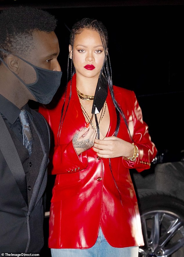 Coordinated look: Riri, 33, matched the color of her blazer with the same shade of lipstick and matching polish on her fingernails