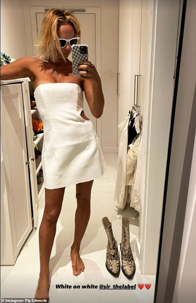 White on the mark! Pip Edwards, 40, (pictured) showed off her incredible figure in a white cleavage-baring mini dress amid rumours she's reunited with Michael Clarke