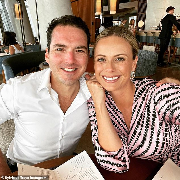 Growing family:Today Extra host Sylvia (pictured with husband Peter) announced she'd given birth on Wednesday and posted two very sweet pictures of her newborn