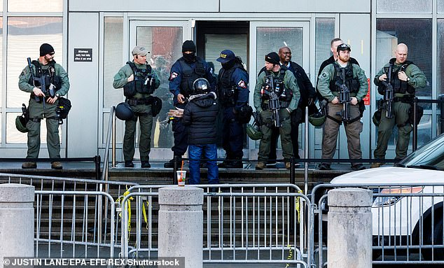Armed federal police officers stand in front of the Metropolitan Detention Center (MDC), a federal prison used mostly for pre-trial detention, in Brooklyn