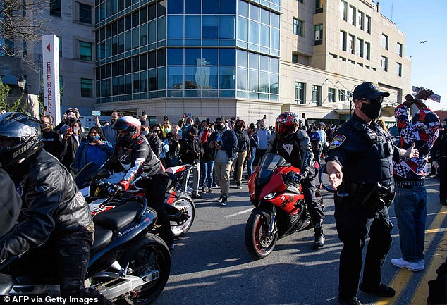 Driving in: Biker fans of hospitalized rapper DMX attend the vigil Monday to pray for the recovery of the 50-year-old