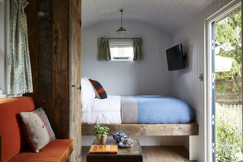 The Artist Residence in Oxfordshire has a hut filled with vintage furniture, pictured, at the end of its garden