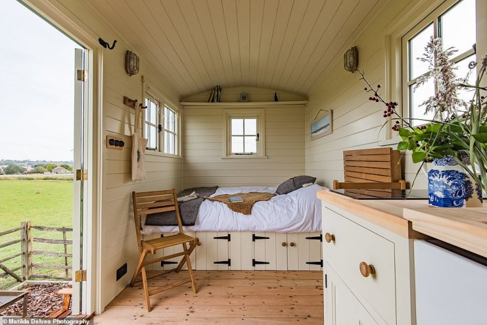 Inside one of the two shepherd's huts at Romney Marsh in Kent, which are stocked with toiletries and woollen goods