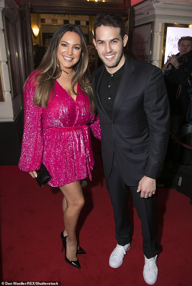 Happy couple: On Tuesday Kelly revealed she's considered proposing to boyfriend of six-years Jeremy Parisi on the next leap year (pictured together in 2020)