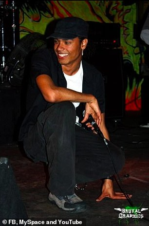 He beams a smile as he rocks a black cap in another gig snap (pictured 2009)