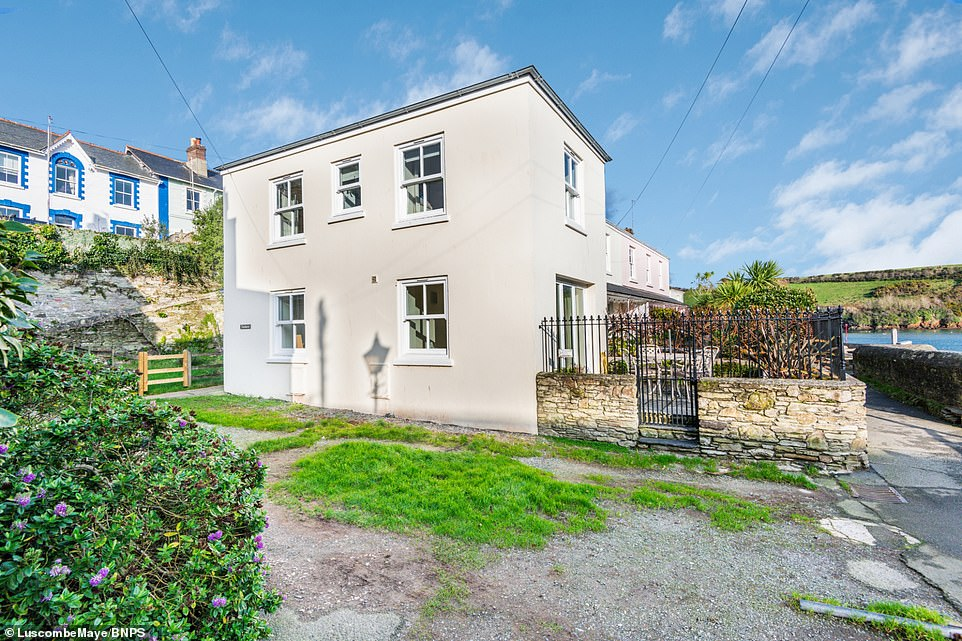 Outside of the property, its south-facing terrace garden offers incredible lines of sight out to sea, while the front bedroom also features stunning views of the estuary