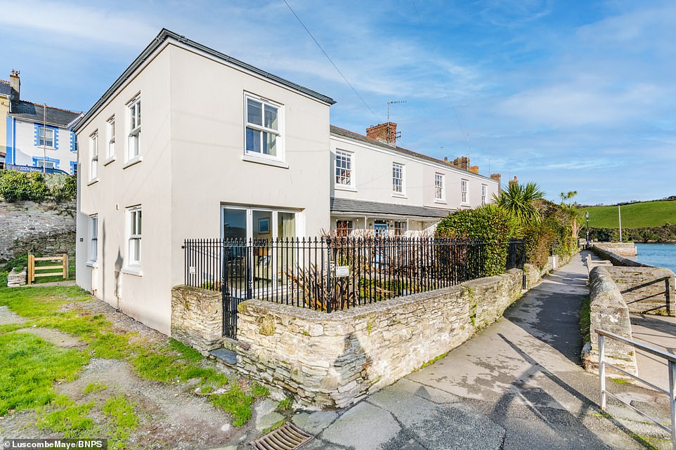 A quaint fisherman's cottage (pictured) originally constructed in the 19th century in an exclusive area of Devon has been put up for sale for £900,000