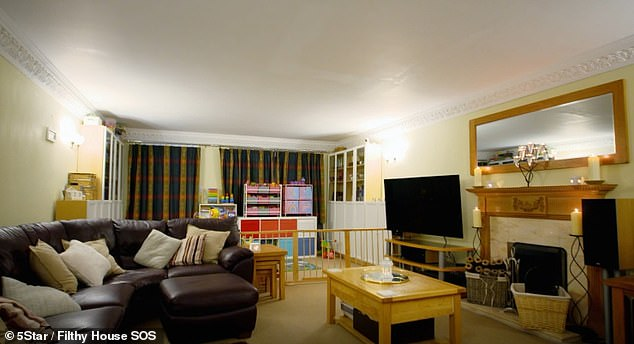 After the transformation, the living-room wad cleared of all the clutter and divided into a seating area was Stuart and Sarah and a play area for their children, pictured