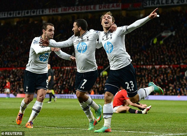 Soldado (left) celebrates with Aaron Lennon (centre) and Christian Eriksen after Tottenham score in their win over United at Old Trafford on New Year's Day 2014