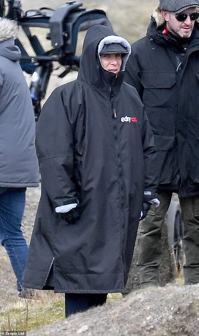 Freezing:Despite bundling up in a thick black hooded coat, the leading actor, 44, looked to be shivering as he prepared to film new scenes for the BBC series on the moors in Lancashire