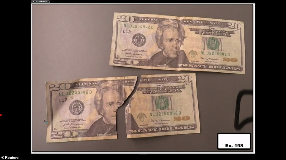 Jurors were shown two $20 bills found at the scene; one was ripped in half, pictured