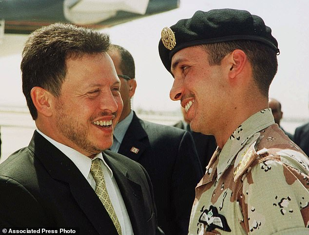 In this April 2, 2001, file photo, Jordan's King Abdullah II laughs with his half brother Prince Hamzah, right, shortly before the monarch embarked on a tour of the United States. Abdullah and Hamzah are both sons of the beloved King Hussein, who ruled Jordan for nearly a half-century before his death in 1999. Abdullah had appointed Hamzah as crown prince upon his succession but stripped him of the title in 2004