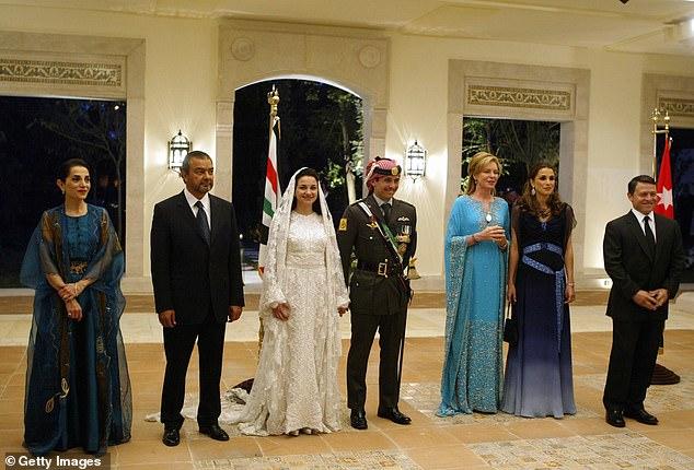Jordan's King Abdullah II, his wife Queen Rania, Queen Noor, mother of the groom, Crown Prince Hamzeh, the groom, his bride Princess Noor, Sherif Asem bin-Nayef and his ex-wife Firouzeh Vokhshouri, parents of the bride, attend the royal wedding on May 27, 2004 in Amman, Jordan. Hamzeh and Noor registered their marriage on August 29, 2003