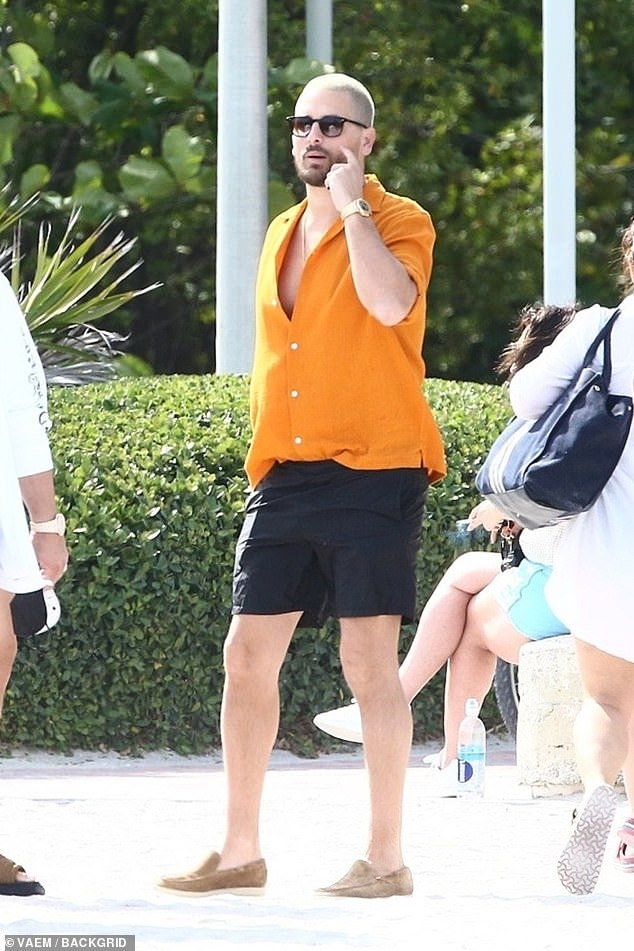 Blonde: Scott was certainly feeling the Miami heat as he stepped out wearing a vibrant orange button-down shirt with black shorts