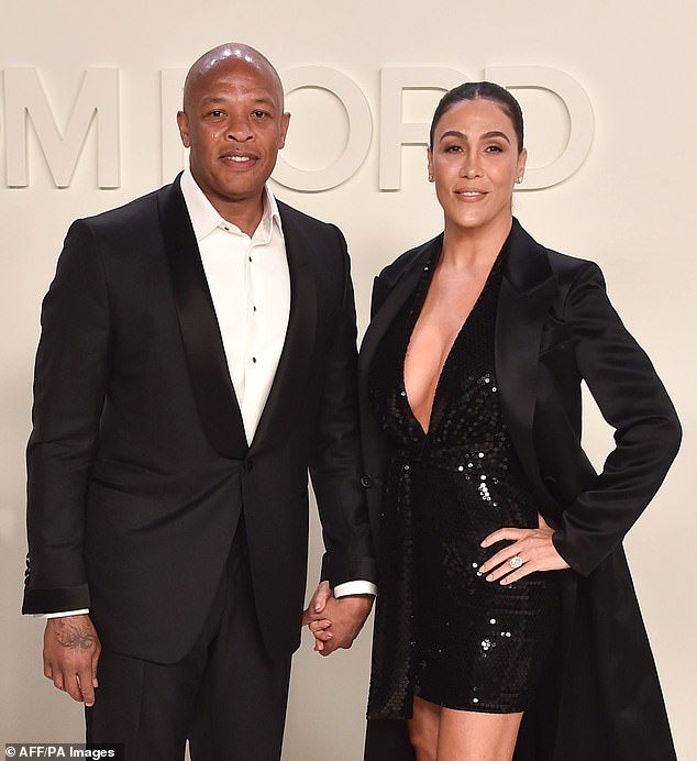 Dr Dre has been ordered to let his estranged wife Nicole Young (pictured together last February) into his Los Angeles home so she can collect her things and 'inspect documents'