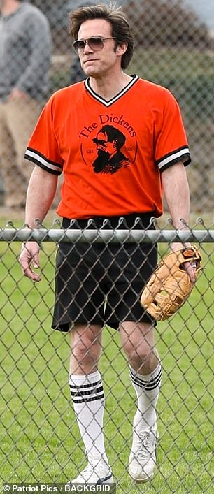 Appropriate attire: Affleck was dressed in an orange uniform shirt bearing a graphic for his team's bar