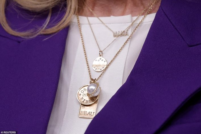 The first lady wore a necklace with a pendant with the name of her son Beau; Beau Biden served in the National Guard before his death from cancer at 2015