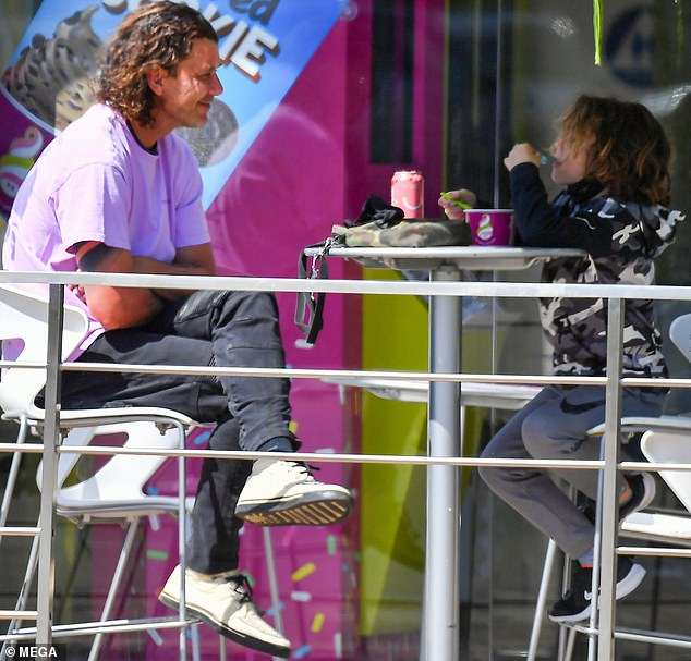 Cooling off:The 55-year-old singer let his mullet down while surfacing from lockdown to take Apollo out to enjoy a frozen yogurt