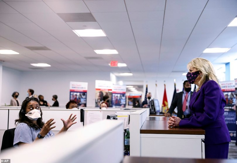 Jill Biden talks to a staff member at Military One Source, an active duty military resource hub/call center for service members, their family and survivors, in Arlington, Va.