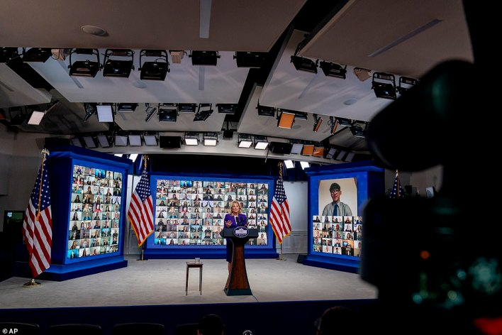 Jill Biden was joined at her announcement, virtually, by U.S. military families and others from around the world, a total of more than 100 people appearing in individual boxes on screens behind her on the stage