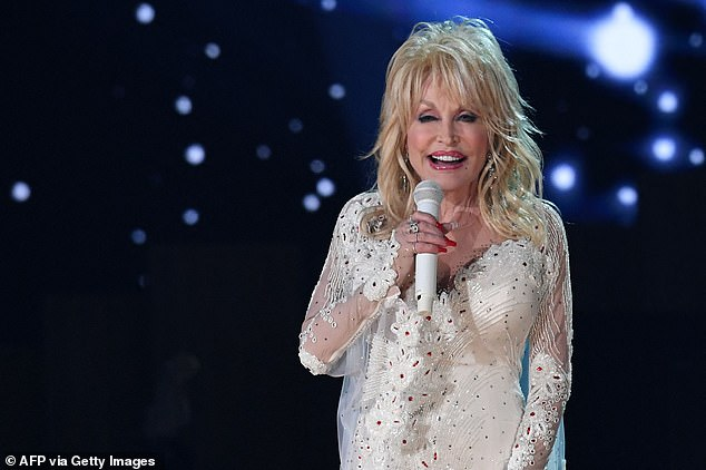 Caption: Parton was pictured performing on stage at the 2019 Grammy Awards