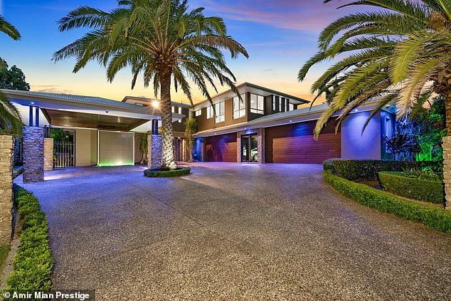 Dennis and Sharon Clark have lived in their Queensland home for 10 years - which features 14 holes of golf and a swim-up bar.