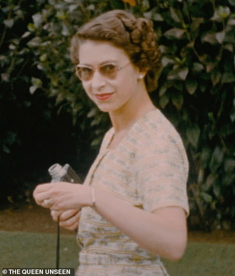 A young Queen filming with a Cine Camera at the outdoor swimming pool on Christmas Day 1953. In a rare and unseen private home movie, we get a glimpse of the young Queen off duty. Taking a short break from the gruelling tour, the royal couple stayed with New Zealand's Governor General, Sir Willougby Norrie, whose wife filmed the visit which took place over Christmas in 1953. Charles Anson describes the Queen's true personality: 'The Queen is, by nature, quite a shy person. Her temperament and personality is on the side of being reserved and being holding back slightly'